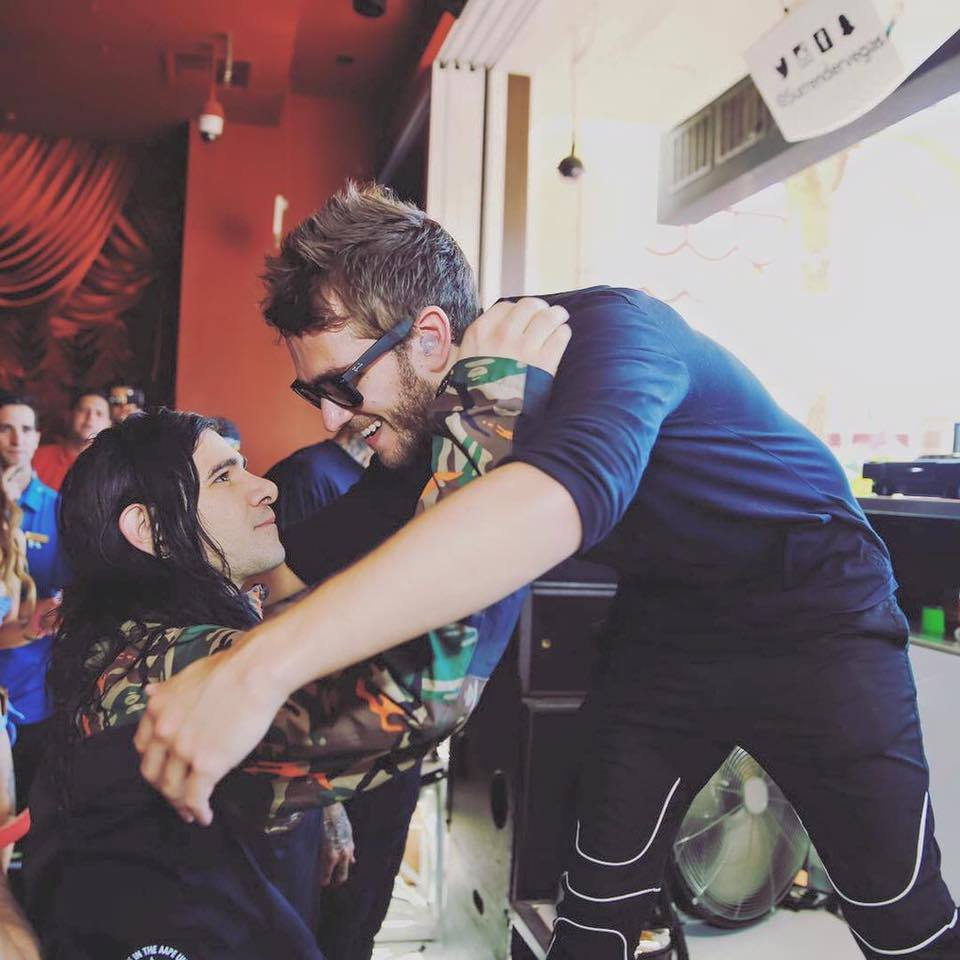 Zedd and Skrillex hug